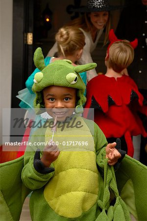 Portrait of Boy with other Children Trick or Treating at Halloween Stock Photo - Premium Royalty-Free, Image code: 600-01717696