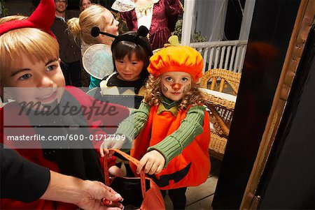 Children Trick or Treating at Halloween Stock Photo - Premium Royalty-Free, Image code: 600-01717709