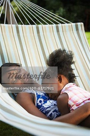 Mother and Daughter Sleeping in Hammock Stock Photo - Premium Royalty-Free, Image code: 600-01717921
