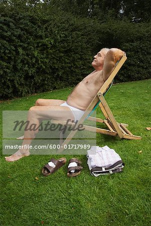 Man Sitting in Lawn Chair in His Underwear Stock Photo - Premium Royalty-Free, Image code: 600-01717989