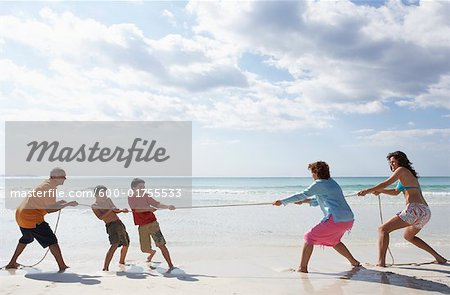 Family Playing Tug-of-War on the Beach Stock Photo - Premium Royalty-Free, Image code: 600-01755533