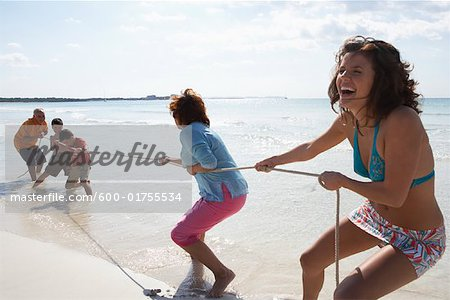 Family Playing Tug-of-War on the Beach Stock Photo - Premium Royalty-Free, Image code: 600-01755534