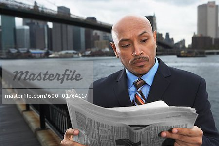 Businessman by Brooklyn Bridge, New York City, New York, USA