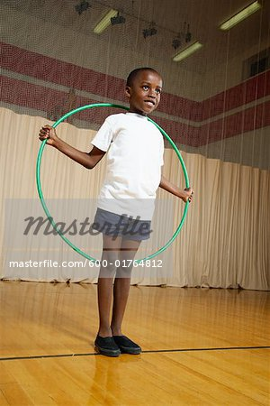 Boy With Hula Hoop Stock Photo - Premium Royalty-Free, Image code: 600-01764812