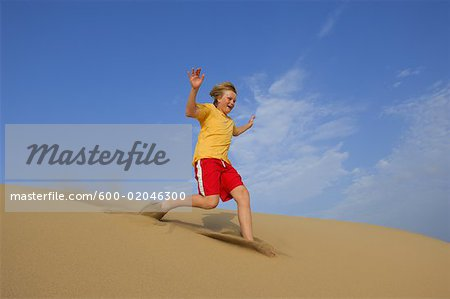 Boy Playing in Sand Dunes, Playa del Ingles, Cran Canaria, Canary Islands Stock Photo - Premium Royalty-Free, Image code: 600-02046300