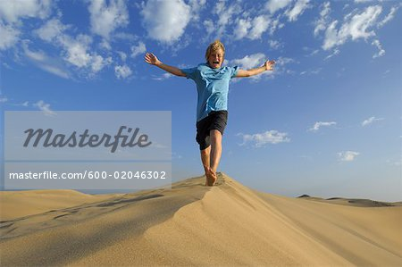 Boy Playing in Sand Dunes, Playa del Ingles, Cran Canaria, Canary Islands Stock Photo - Premium Royalty-Free, Image code: 600-02046302