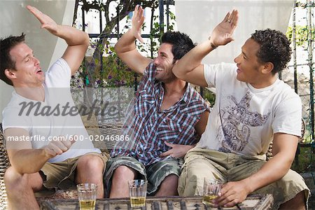 Men at a Party Stock Photo - Premium Royalty-Free, Image code: 600-02046886