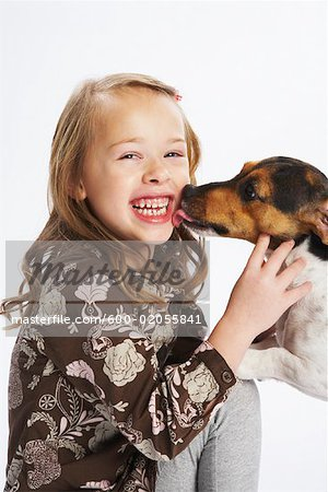 Girl with Dog Stock Photo - Premium Royalty-Free, Image code: 600-02055841