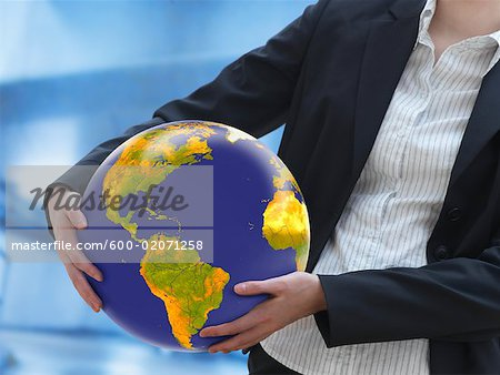 Woman Holding Earth Stock Photo - Premium Royalty-Free, Image code: 600-02071258