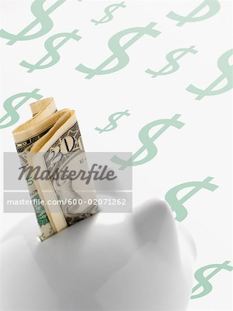 American Currency in Piggy Bank Stock Photo - Premium Royalty-Free, Image code: 600-02071262