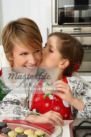 Mother and Daughter Making Christmas Cookies Stock Photo - Premium Royalty-Free, Image code: 600-02071850