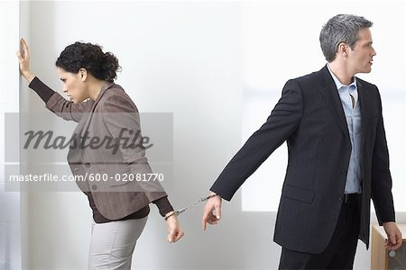 Businessman and Businesswoman Handcuffed Together Stock Photo - Premium Royalty-Free, Image code: 600-02081770