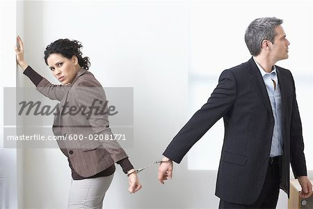 Businessman and Businesswoman Handcuffed Together Stock Photo - Premium Royalty-Free, Image code: 600-02081771