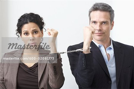 Businessman and Businesswoman Handcuffed Together Stock Photo - Premium Royalty-Free, Image code: 600-02081773