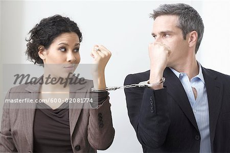 Businessman and Businesswoman Handcuffed Together Stock Photo - Premium Royalty-Free, Image code: 600-02081774