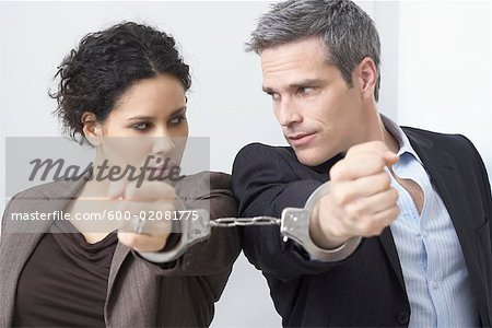 Businessman and Businesswoman Handcuffed Together Stock Photo - Premium Royalty-Free, Image code: 600-02081775