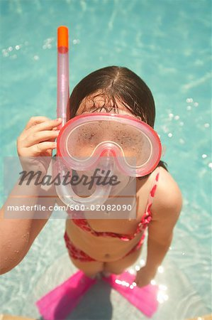 Girl Wearing Snorkel and Goggles Stock Photo - Premium Royalty-Free, Image code: 600-02082090