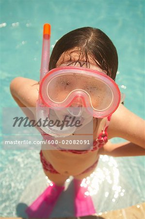 Girl Wearing Snorkel and Goggles Stock Photo - Premium Royalty-Free, Image code: 600-02082091