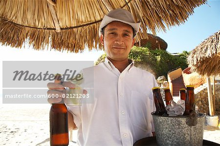 Portrait of Waiter at Beach, Mexico Stock Photo - Premium Royalty-Free, Image code: 600-02121203