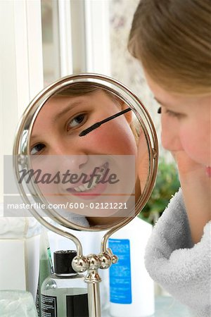 Girl Applying Mascara Stock Photo - Premium Royalty-Free, Image code: 600-02121221