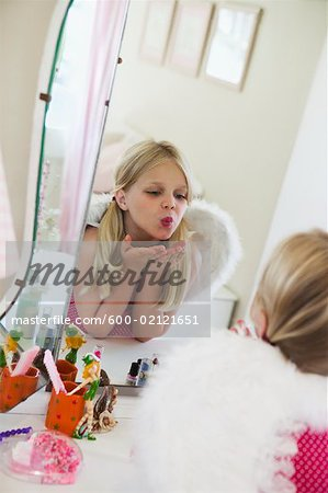 Girl Playing Dress Up Stock Photo - Premium Royalty-Free, Image code: 600-02121651