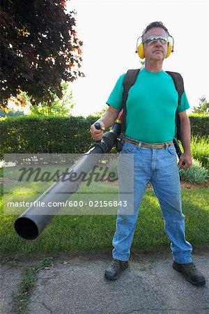 Man Holding Leaf Blower Stock Photo - Premium Royalty-Free, Image code: 600-02156843