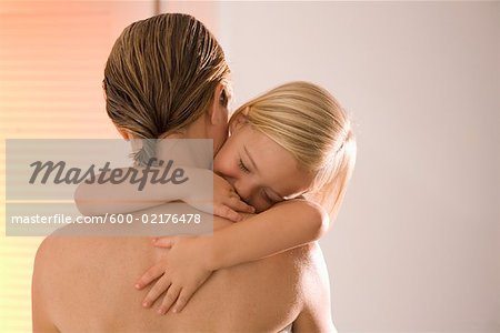 Mother Holding Sleeping Daughter Stock Photo - Premium Royalty-Free, Image code: 600-02176478