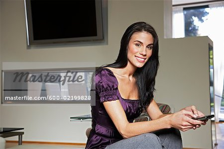 Woman Using Electronic Organizer