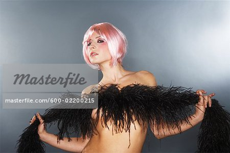 Portrait of Woman With Feather Boa Stock Photo - Premium Royalty-Free, Image code: 600-02200215