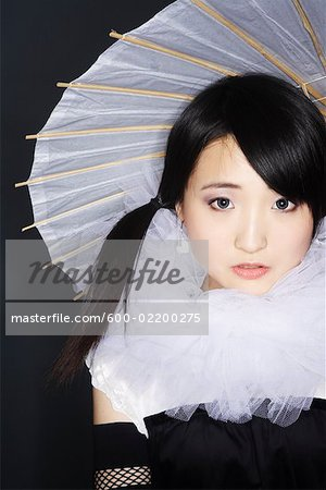 Portrait of Woman With Parasol Stock Photo - Premium Royalty-Free, Image code: 600-02200275