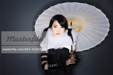 Portrait of Woman With Parasol Stock Photo - Premium Royalty-Free, Image code: 600-02200277