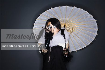 Portrait of Woman With Parasol and Opera Glasses Stock Photo - Premium Royalty-Free, Image code: 600-02200278