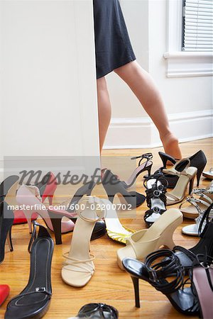 Woman Getting Dressed Stock Photo - Premium Royalty-Free, Image code: 600-02200702