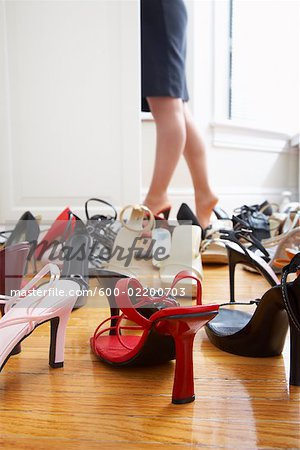Woman Getting Dressed Stock Photo - Premium Royalty-Free, Image code: 600-02200703