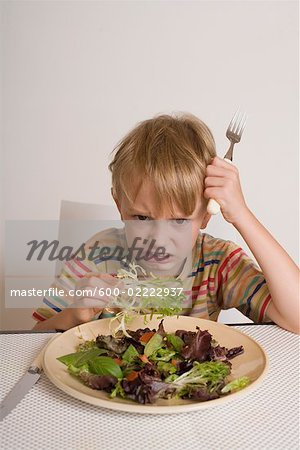 Boy Refusing to Eat Salad Stock Photo - Premium Royalty-Free, Image code: 600-02222937