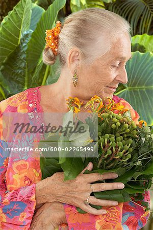 Profile of Woman Holding Plant Stock Photo - Premium Royalty-Free, Image code: 600-02265499