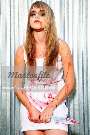 Portrait of Bloodied Woman Carrying a Butcher's Knife Stock Photo - Premium Royalty-Free, Image code: 600-02289242