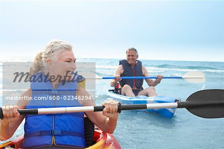 Woman and Man Kayaking Stock Photo - Premium Royalty-Free, Image code: 600-02346294