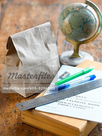 School Supplies, Lunch Bag and Globe on Desk Stock Photo - Premium Royalty-Free, Image code: 600-02348718