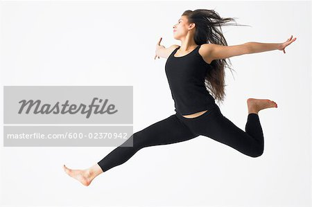 Woman Jumping in Mid-air Stock Photo - Premium Royalty-Free, Image code: 600-02370942