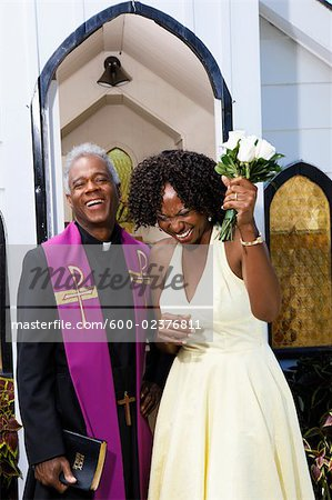 Minister and Bridesmaid in Front of Chapel Stock Photo - Premium Royalty-Free, Image code: 600-02376811