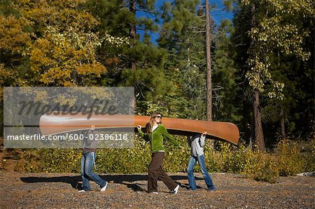 Three Women Carrying Canoe in the Forest Stock Photo - Premium Royalty-Free, Image code: 600-02386118