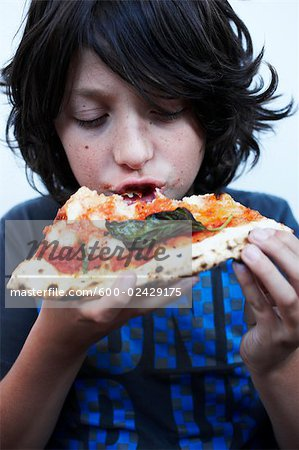 Boy Eating Pizza Stock Photo - Premium Royalty-Free, Image code: 600-02429175