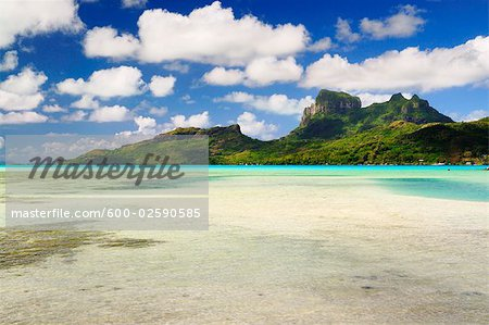 Overview of Bora Bora and Lagoon from Motu Mute, French Polynesia Stock Photo - Premium Royalty-Free, Image code: 600-02590585