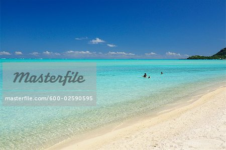 People in Water, Matira Beach, Bora Bora, French Polynesia Stock Photo - Premium Royalty-Free, Image code: 600-02590595