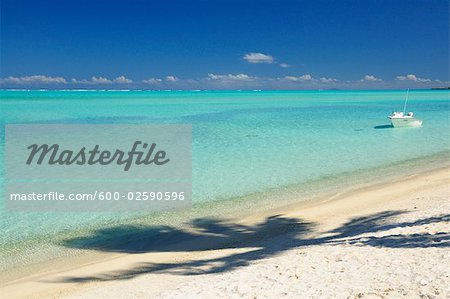 Boat in Water by Beach, Matira Beach, Bora Bora, French Polynesia Stock Photo - Premium Royalty-Free, Image code: 600-02590596