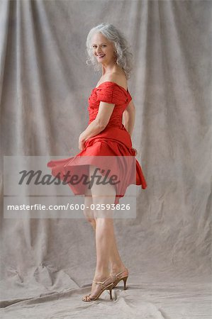 Seductive Woman Wearing Red Dress Stock Photo - Premium Royalty-Free, Image code: 600-02593826