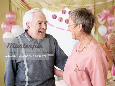 Birthday Party in Retirement Home Stock Photo - Premium Royalty-Free, Image code: 600-02637672
