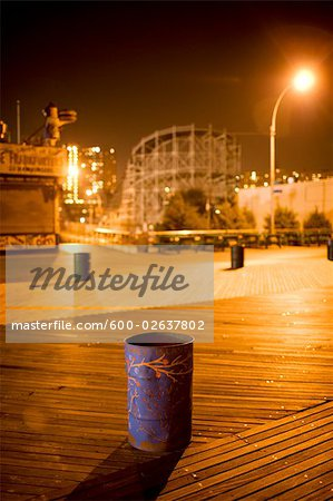 Trash Can on Boardwalk at Night, Luna Park, Coney Island, New York City, New York, USA Stock Photo - Premium Royalty-Free, Image code: 600-02637802