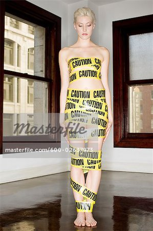 Woman Wrapped in Emergency Tape, Los Angeles, California, USA Stock Photo - Premium Royalty-Free, Image code: 600-02637973